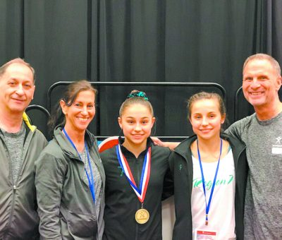 Submitted Photo The Wehry girls are pictured with their gymnastic coaches. Pictured are from left, Coach Joe Stallone, Coach Gina Stallone Amrich, Emma Wehry, Grace Wehry, and Coach Marty Amrich.